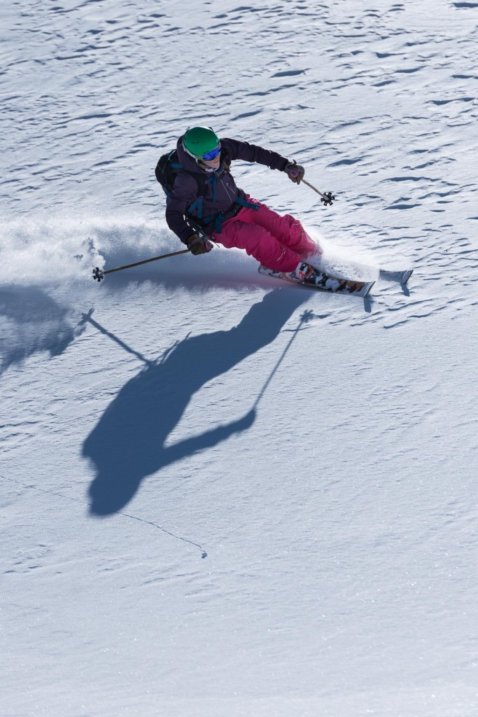 skier in wind rippled powder snow at Treble Cone Ski Area New Zealand